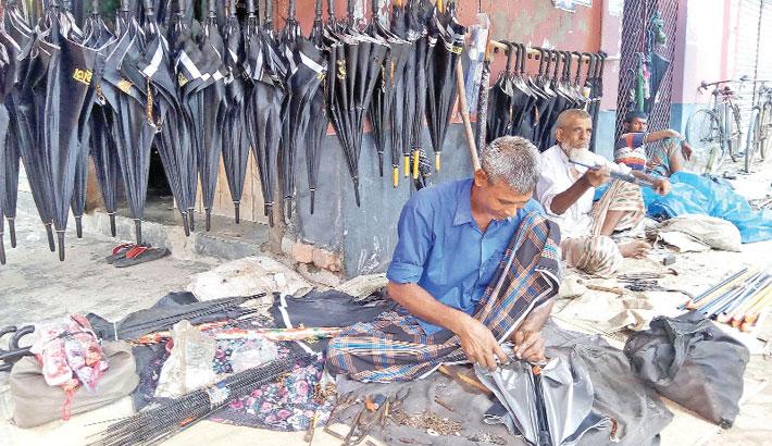 Umbrella mender are busy repairing umbrella