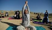 India celebrates low-key International Yoga Day during virus crisis