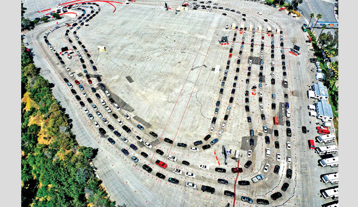 An aerial view of people in cars lined up to be tested for COVID-19