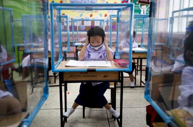 Thai children return to school at last