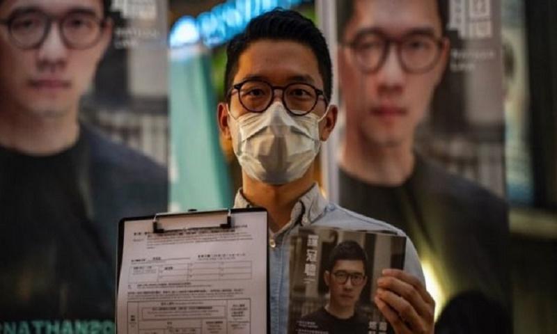 Nathan Law: Prominent democracy activist flees Hong Kong