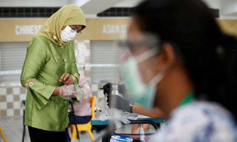 Singapore election held against backdrop of pandemic and recession
