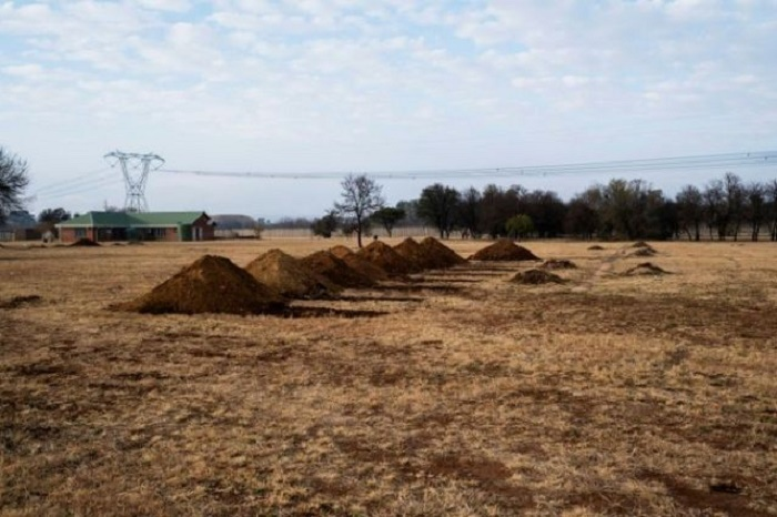 Graves dug for coronavirus victims spook South Africans