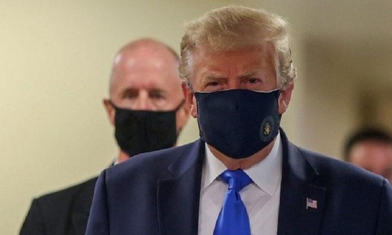Coronavirus: Donald Trump finally wears mask in public