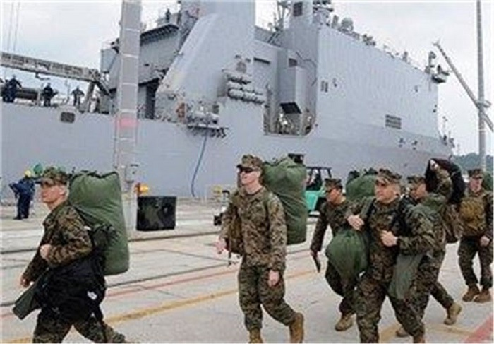 US bases on Okinawa locked down over virus spike