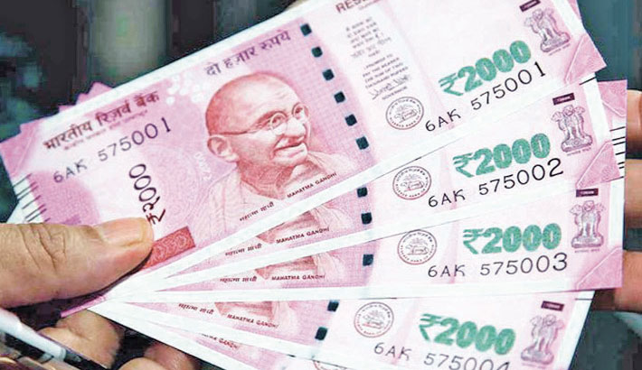 Rupee slips against US dollar