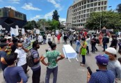 Protesters stage sit-in demanding removal of health minister