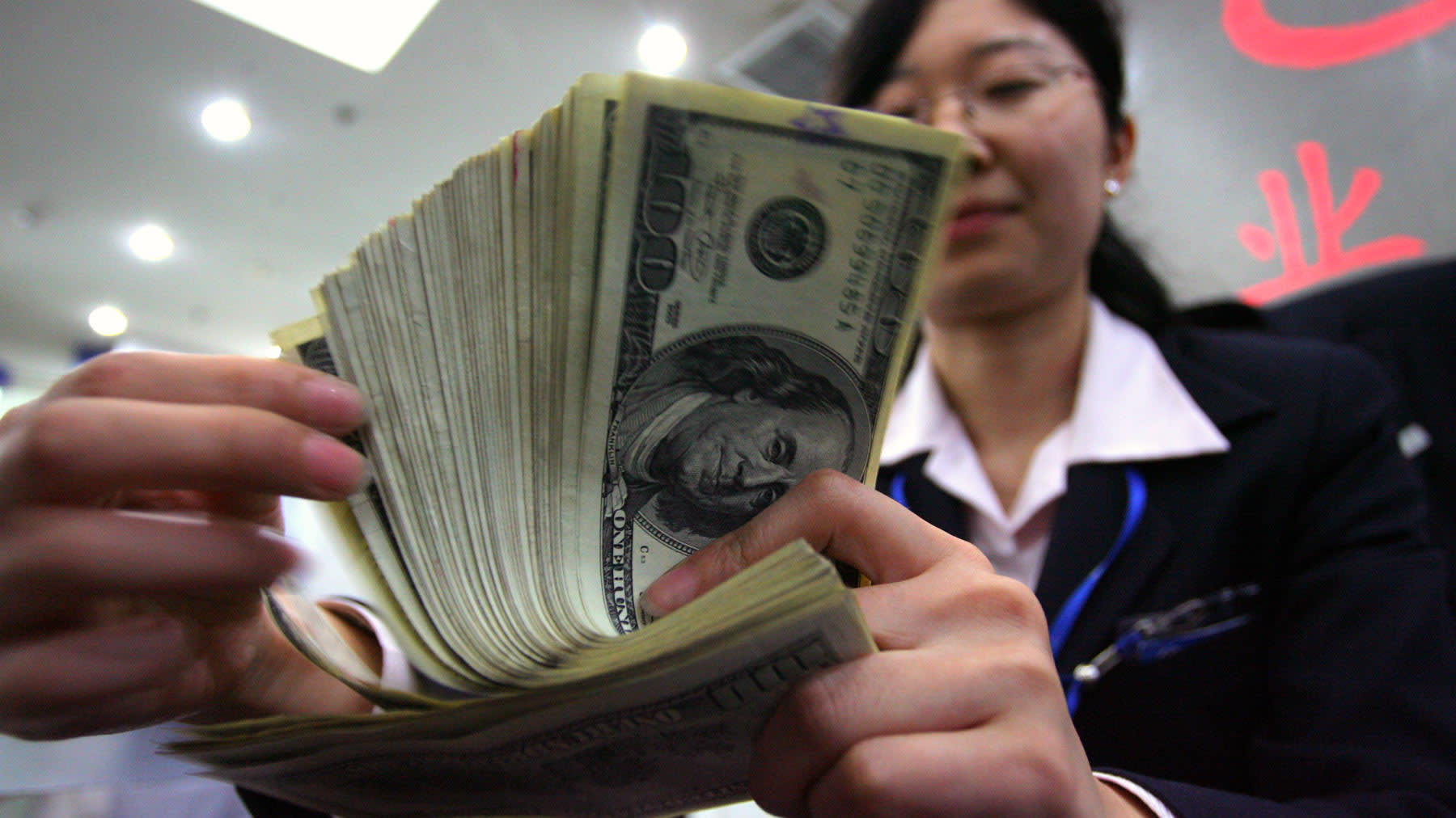 US threatens to cut off Chinese banks' access to dollars