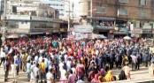 RMG workers block Abdullahpur-Ashulia road demanding wages