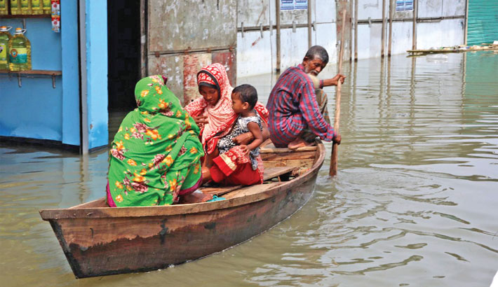Boat carrying a flood-hit family is moving to safe place