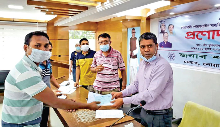Hands over financial assistance cheques