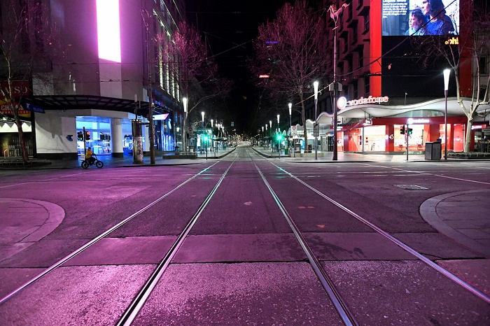 Global virus cases top 18 million as Australian city imposes curfew