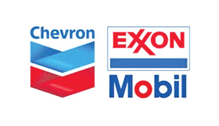 US oil giants report big losses