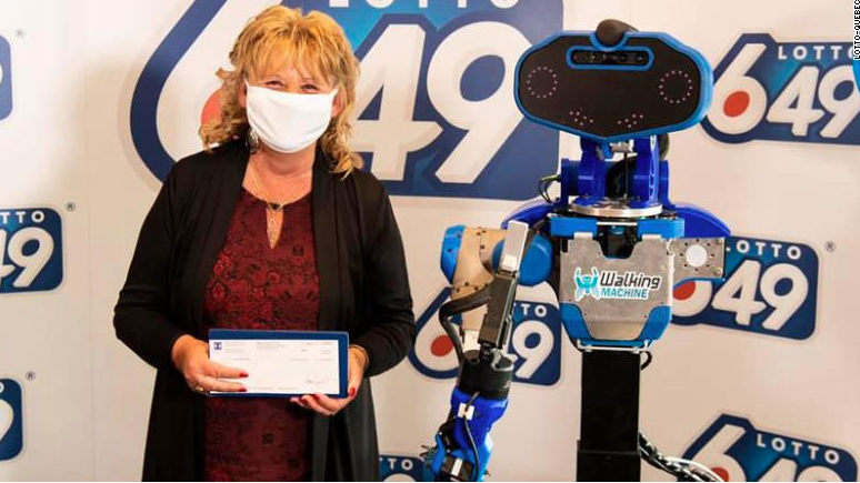 A lottery prize winner got her cheque from a robot