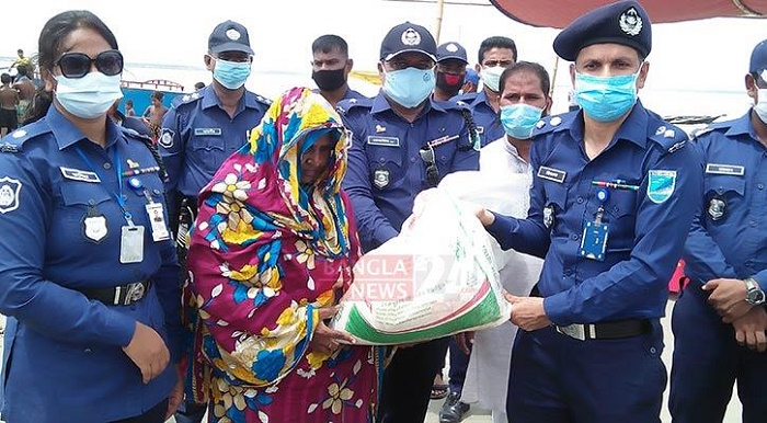 Bashundhara Group distributes food aid among flood-hit people