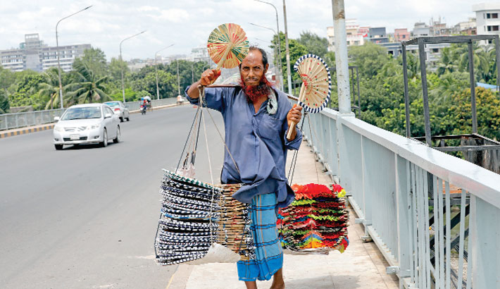 A man sells colourful hand fans