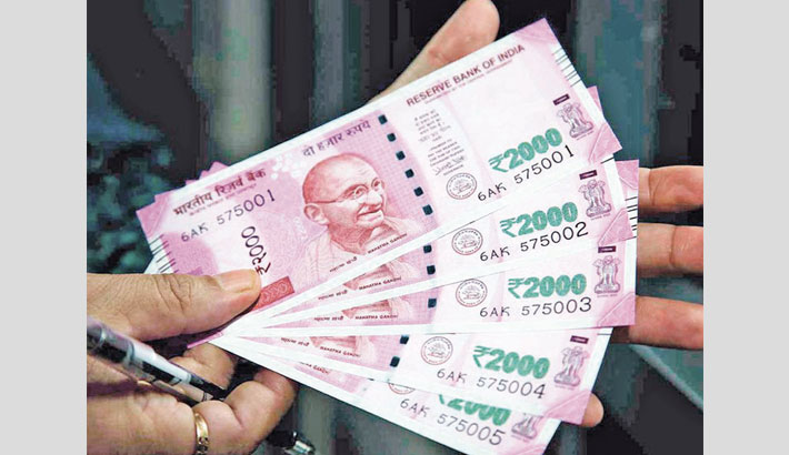 Indian rupee settles higher against USD