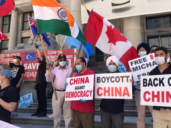 People Stage protest against Beijing near Chinese Consulate in Vancouver