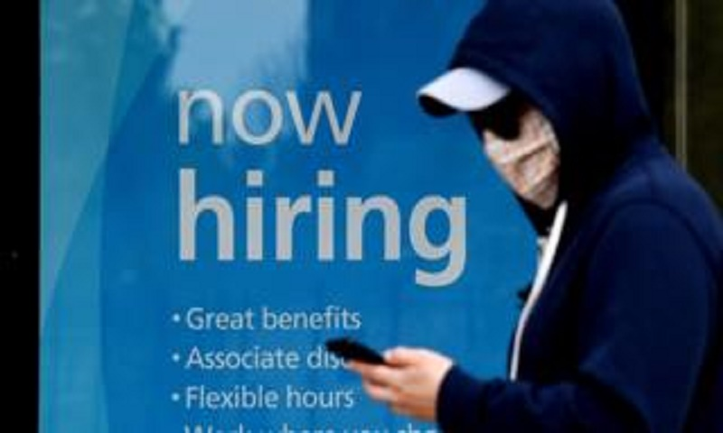 US jobless claims drop below 1m in virus first