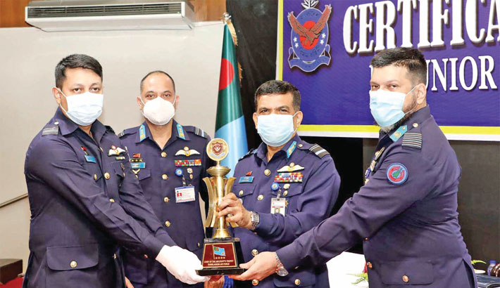 Hands over the 'Chief of Air Staff's Certificate and Trophy'