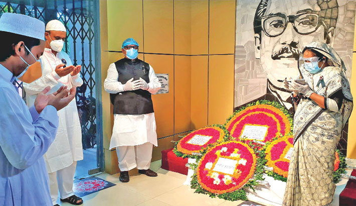 Food Minister Sadhan Chandra Majumder offers prayers after placing a wreath