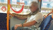 Snake used as face mask on bus