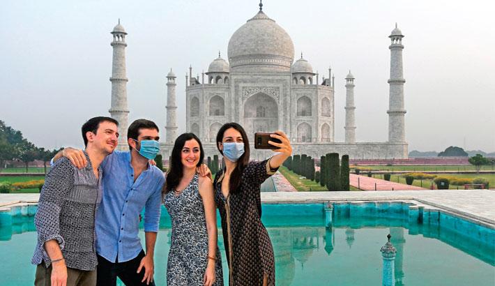 Taj Mahal reopens as India corona cases soar