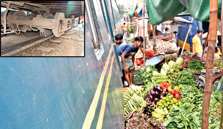 Four bogies of a passenger train derail into a kitchen market in front of Bose Cabin