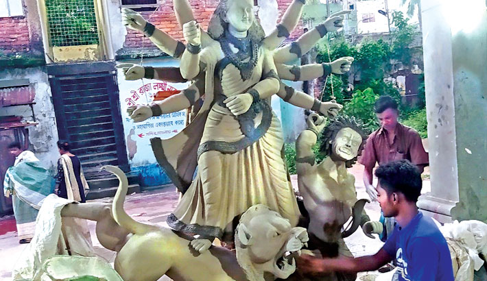 Artisans are busy giving finishing touch to the idols of Goddess Durga