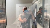 Man peels plastic off of mirror, oddly satisfying video amuses people