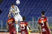 Ronaldo double rescues a point for Juventus at Roma