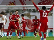 Liverpool lay down Premier League marker in Arsenal win