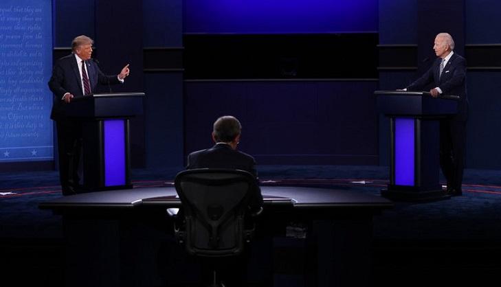 Biden faces down raging Trump in chaotic debate