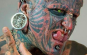 Tattoo addict shares jaw-dropping photo of how he looked before inkings