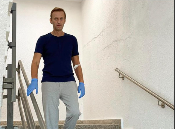 Navalny blames Putin for poisoning, vows to return to Russia