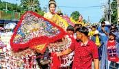 Thailand's  annual buffalo festival races on despite travel ban