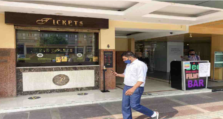 Indian cinemas reopen after going dark for months amid virus