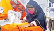 Workers busy sewing blankets