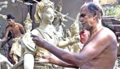 Artisans busy giving finishing touches to idols