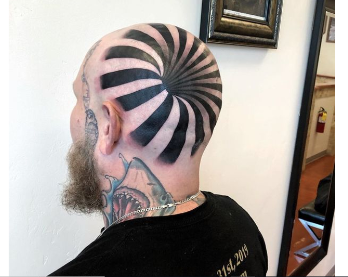 Man's 'insane optical illusion' tattoo looks like giant hole in his head