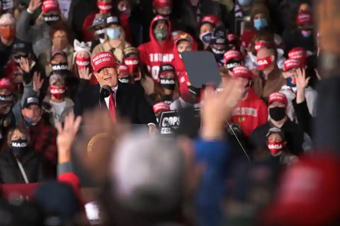 Trump promises free Covid-19 treatment at Wisconsin rally
