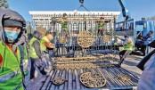 Kyrgyzstan tears down govt gates after crisis