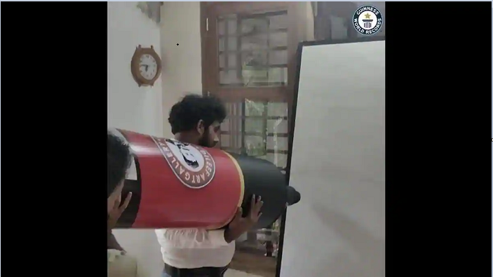 Indian man builds 9-foot-long marker pen for Guinness record