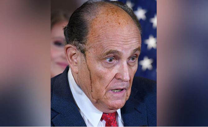 Trump's lawyer appears to sweat hair dye in bizarre press briefing