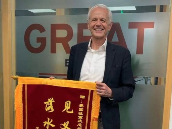 Stephen Ellison: Diplomat who saved drowning woman given banner