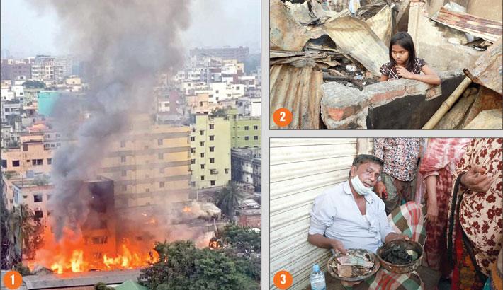 Raging blaze sweeps slums