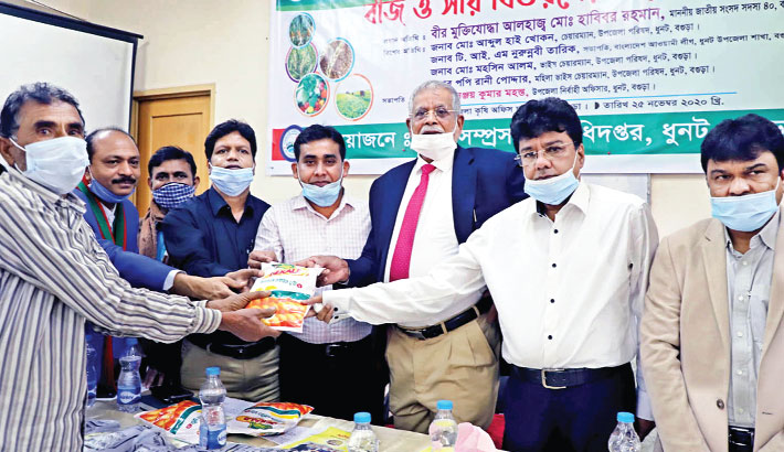 Lawmaker Md Habibar Rahman distributes agri-inputs among the flood-affected farmers