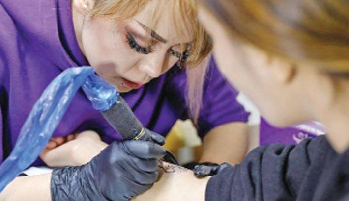 Afghan female artist breaks tattoo taboo