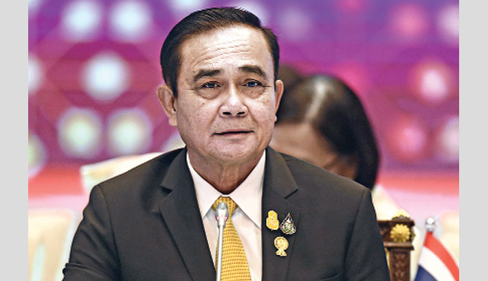 Thailand PM wins legal battle to stay in office