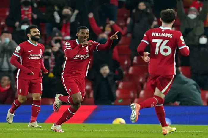 Liverpool spark Anfield party to join Spurs at top of Premier League